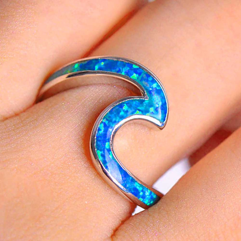 Silver Wave Ring with Blue Opal Stone on finger