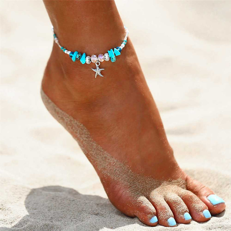 Model wearing a Blue Beaded Starfish Anklet on the beach