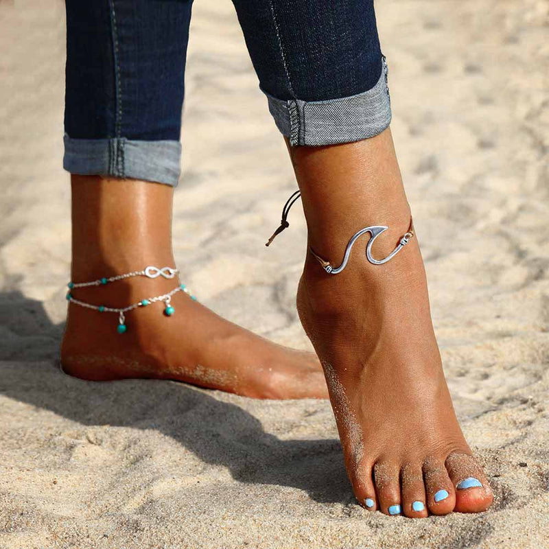 Woman on the beach wearing Wave Anklets