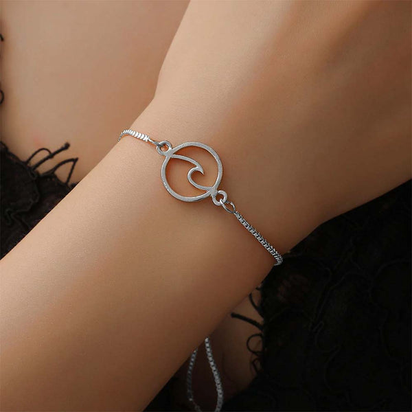 Woman wearing Circular Wave Bracelet in Silver