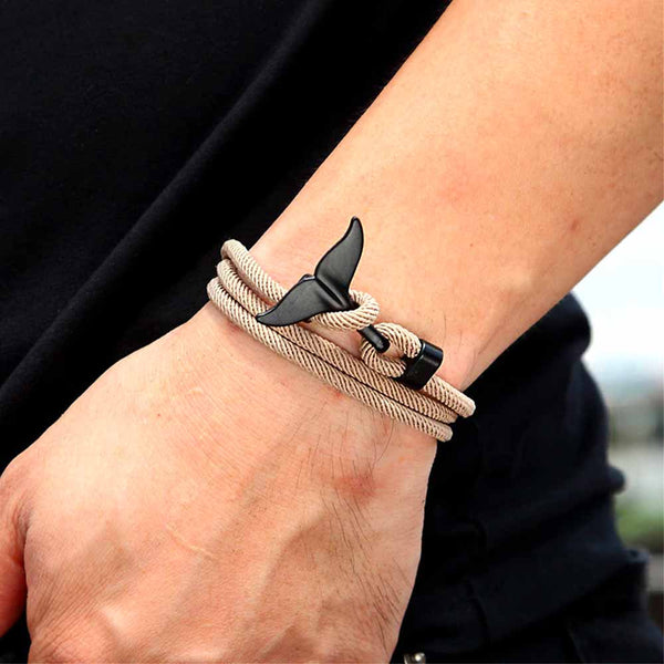 Man's wrist with Brown & Black Whale Tail Bracelet