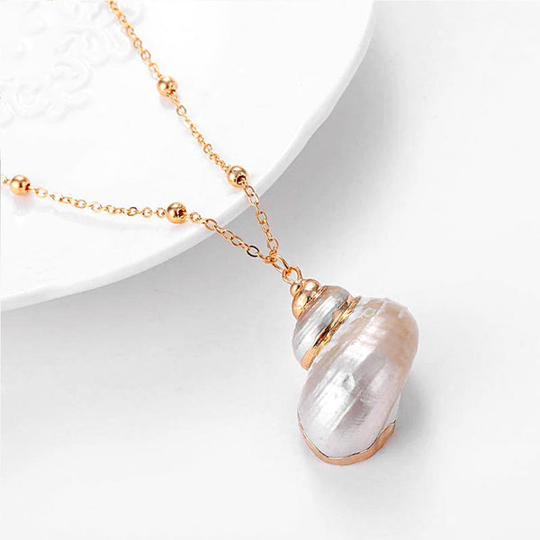 White Pearl Turbo Shell pendant and gold necklace