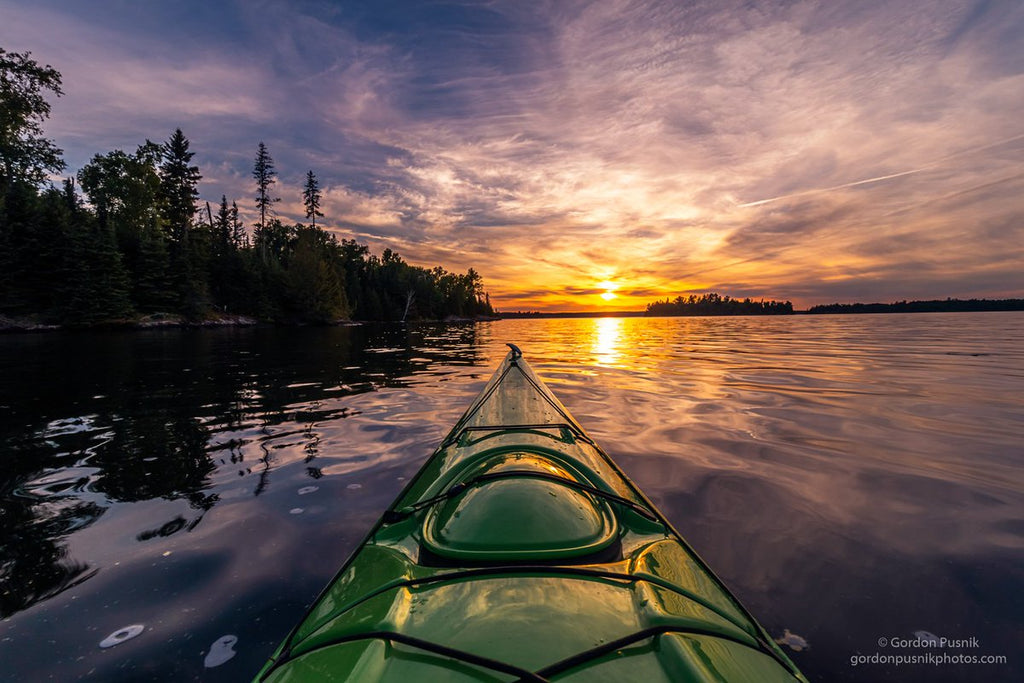 A sunset while out on the water in N.W. Ontario by Gordon Pusnik @gordonpusnik