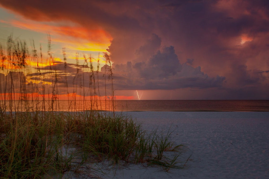 Sunset and a little lightning close out a very beautiful day on St. Pete Beach in Florida by Josh Herrington @PicsTampaBay