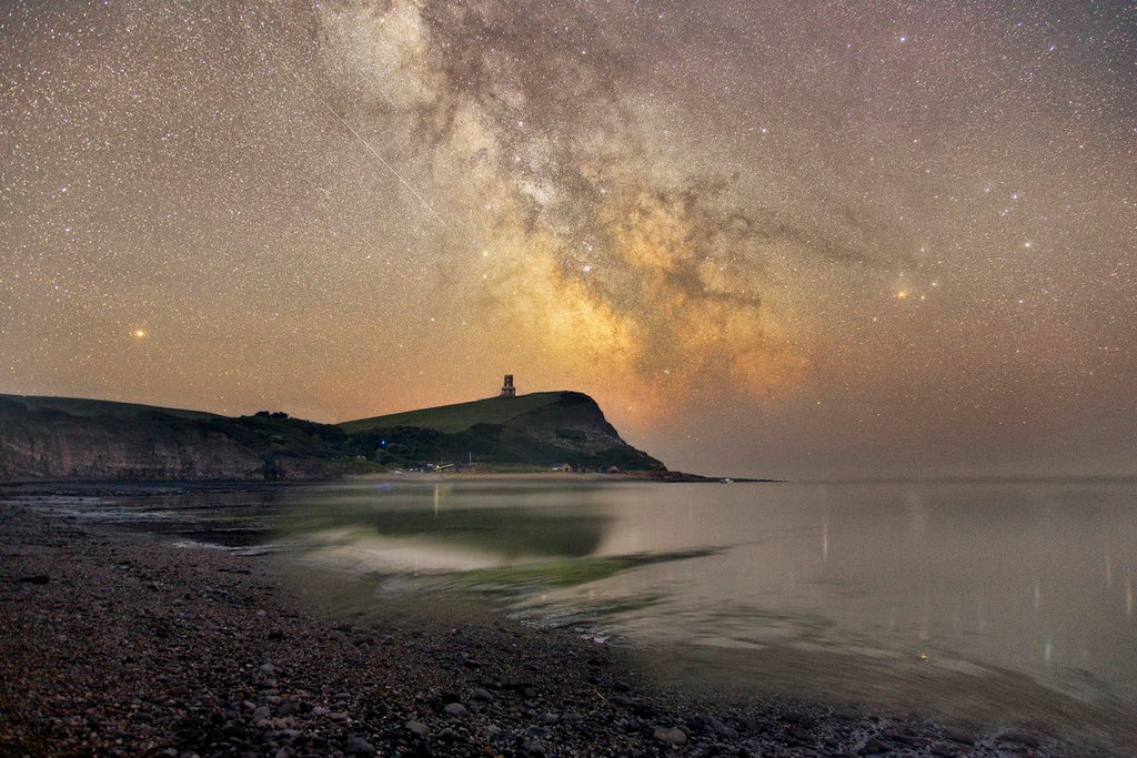 The Milkyway core rises above Clavell Tower overlooking Kimmeridge Bay in Dorset by Mark Pelleymounter @MPelleymounter