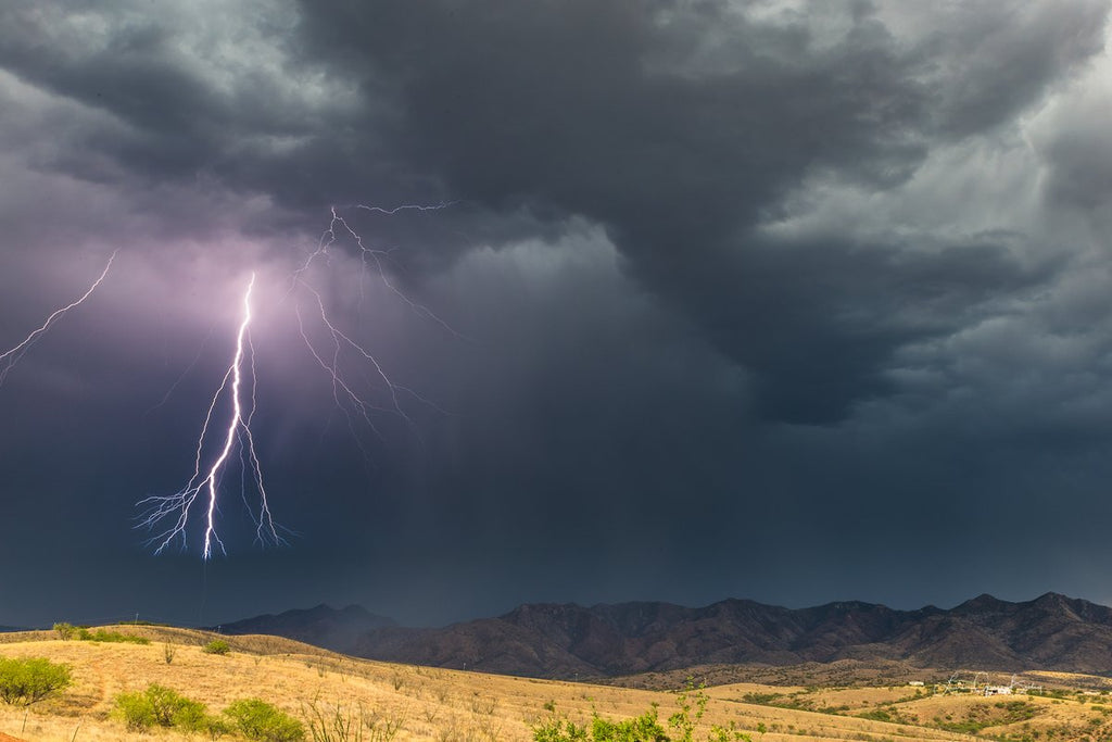 The last bolt from a storm over the Patagonia Mountains in southern AZ by Lori Grace Bailey @lorigraceaz