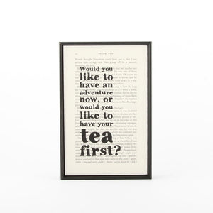 "Peter Pan quote printed on book page ""adventure or tea?""  with thin black wooden frame"