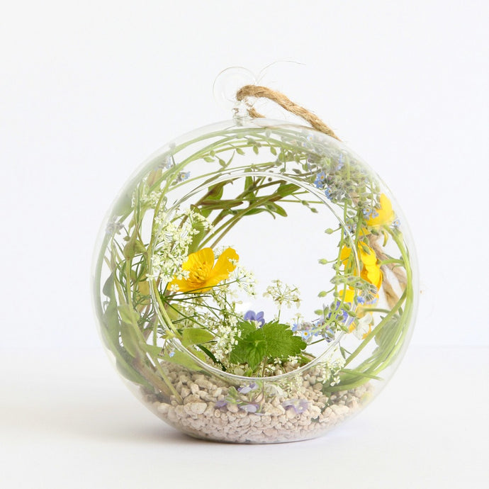 Hanging glass globe with wildflowers