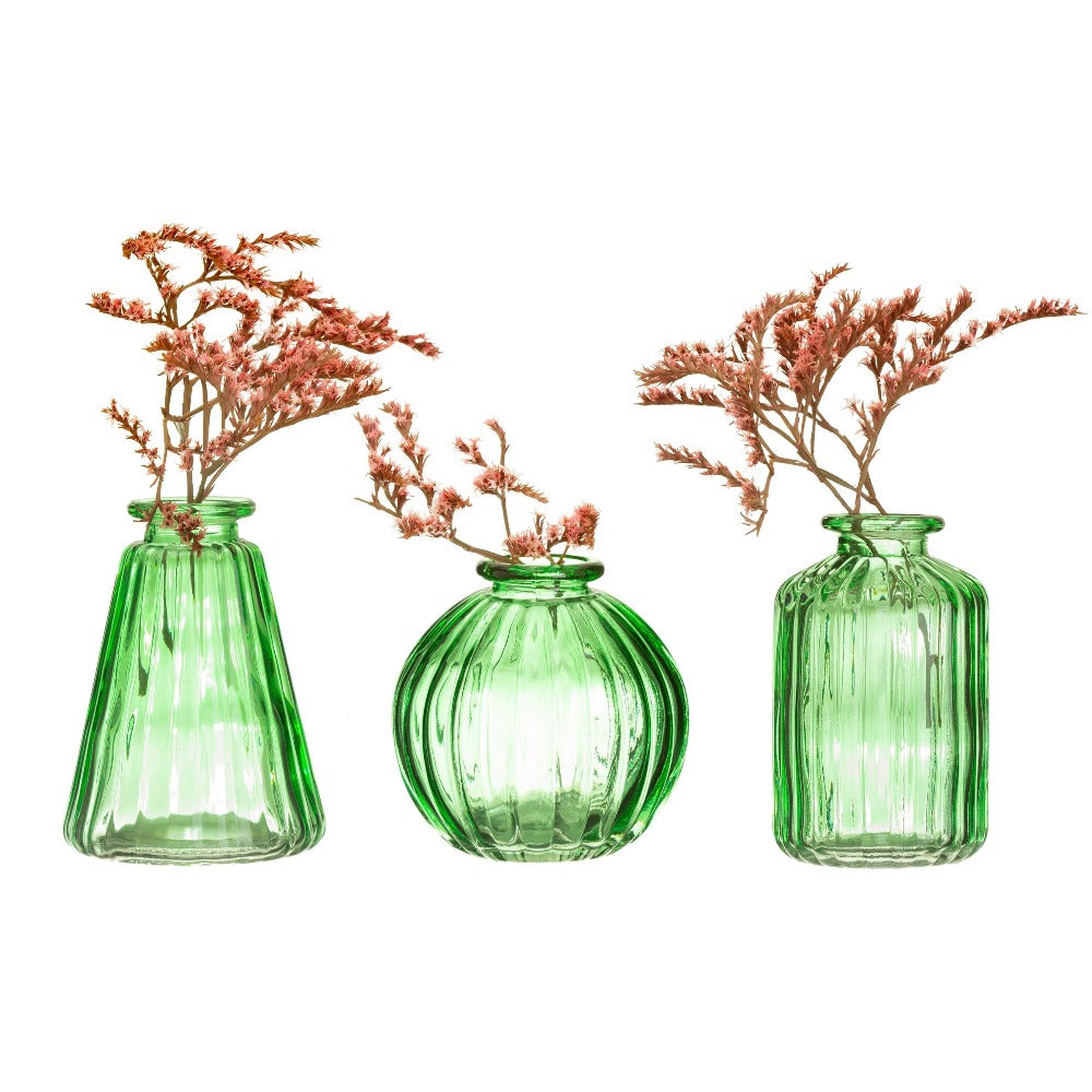 Three green bud vases with flowers