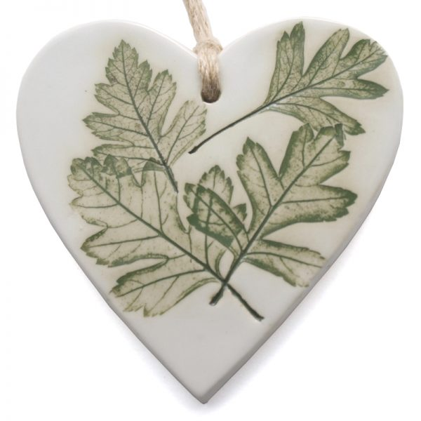 Handmade hanging heart made from clay and pressed leaf impression painted in green