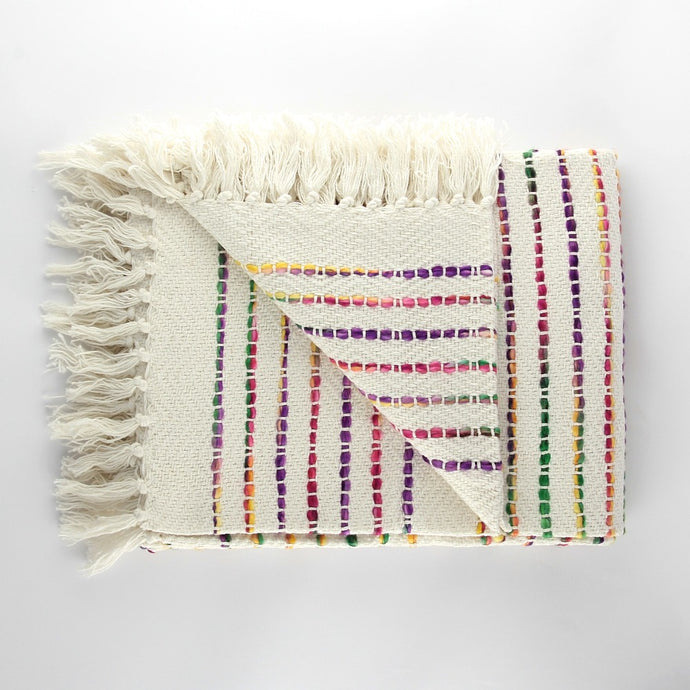 Handloom white cotton throw with tassels and rainbow stripes woven in