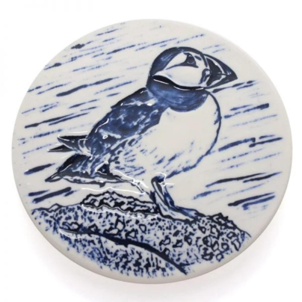 coaster with puffin image hand finished with blue paint