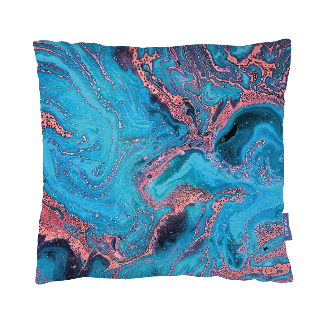 Cushion with blue and pink marbled print