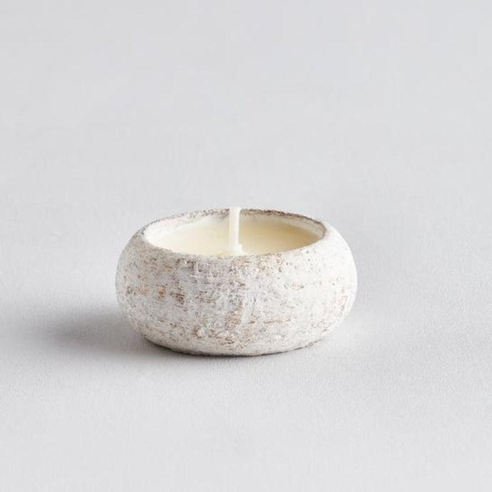 white tealight holder with brushed gold and poured wax with wick