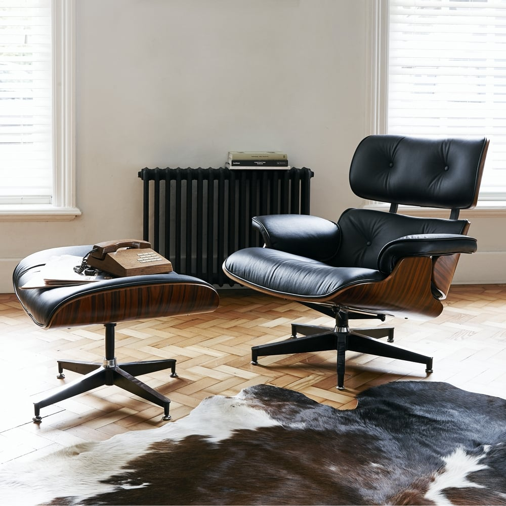 Mid Century and Modern eames style lounge chair and ottoman cowhide rug