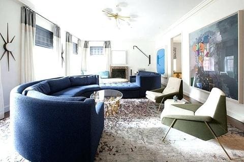 Living room with blue curved velvet sectional sofa