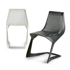 Black and white cantilever chairs