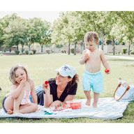 Mom with kids having outdoor picnic on Grey Nook Lilypad2 Best Baby and Toddler Play mat