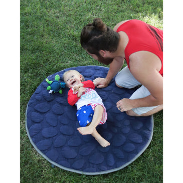 Dad and toddler boy on navy blue LilyPad play mat - best play mat for baby and toddler