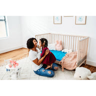 mom and toddler with best breathable baby crib mattress