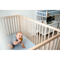 crawling baby in crib on best breathable baby crib mattress