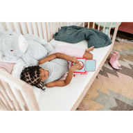 toddler girl on best breathable crib mattress