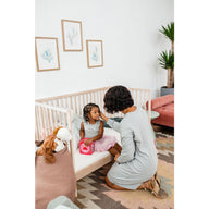 toddler and mom on best breathable crib mattress