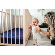 mom and baby with best breathable baby crib mattress