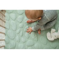baby feeling pebbles on sustainable cotton breathable crib mattress for baby and toddler sea glass