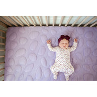 sleeping baby girl on purple best breathable baby crib mattress