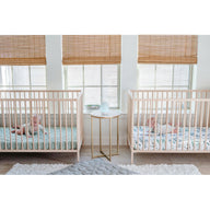 twin nursery with best breathable baby crib mattresses