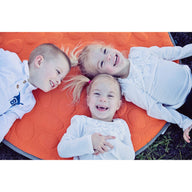 Siblings on orange LilyPad play mat - best play mat for baby and toddler
