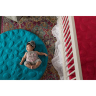 Baby girl on teal LilyPad play mat - best play mat for baby and toddler