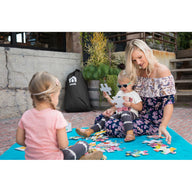Mom playing puzzles with daughters on Teal Nook Lilypad2 Best Baby and Toddler Play mat