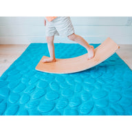Kid playing on Teal Nook Lilypad2 Best Baby and Toddler Play mat