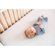 sleeping premature baby on best breathable baby crib mattress
