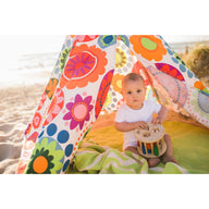 Baby boy at beach in teepee on green LilyPad play mat - best play mat for baby and toddler