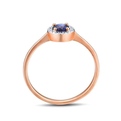 Gold Ring  Decorated with  Blue Sapphire Surrounded by Diamonds