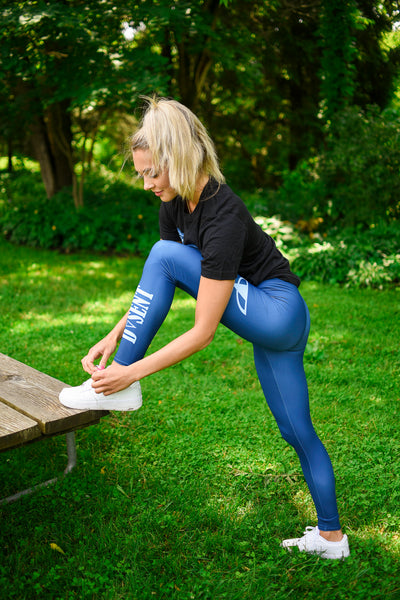 Model in blue leggings