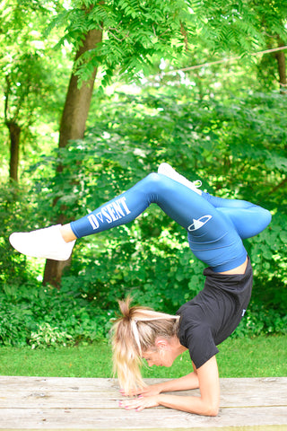 Yoga pose in blue leggings