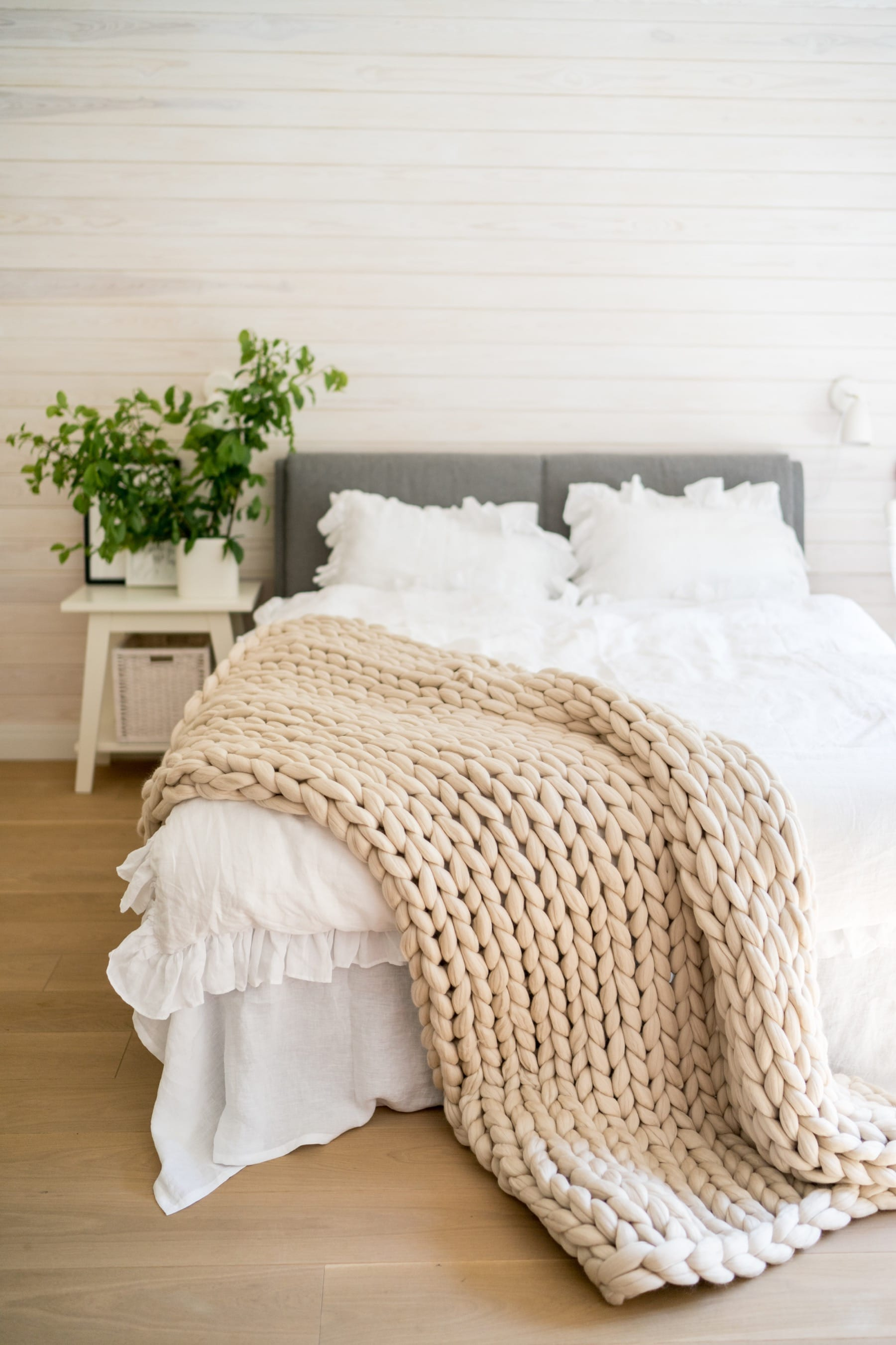 chunky knit blanket on ruffle bedding
