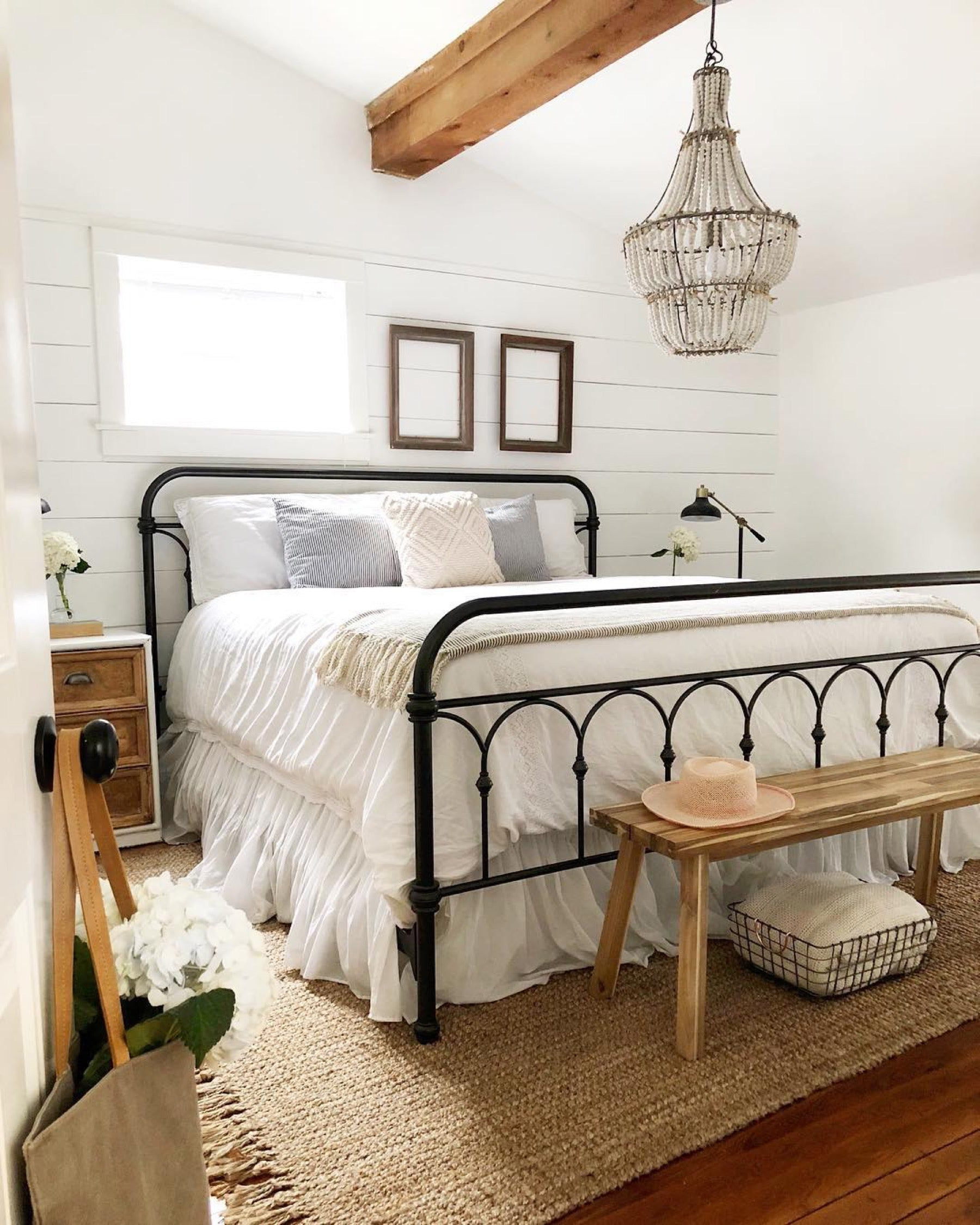 Industrial bed frame in a modern farmhouse