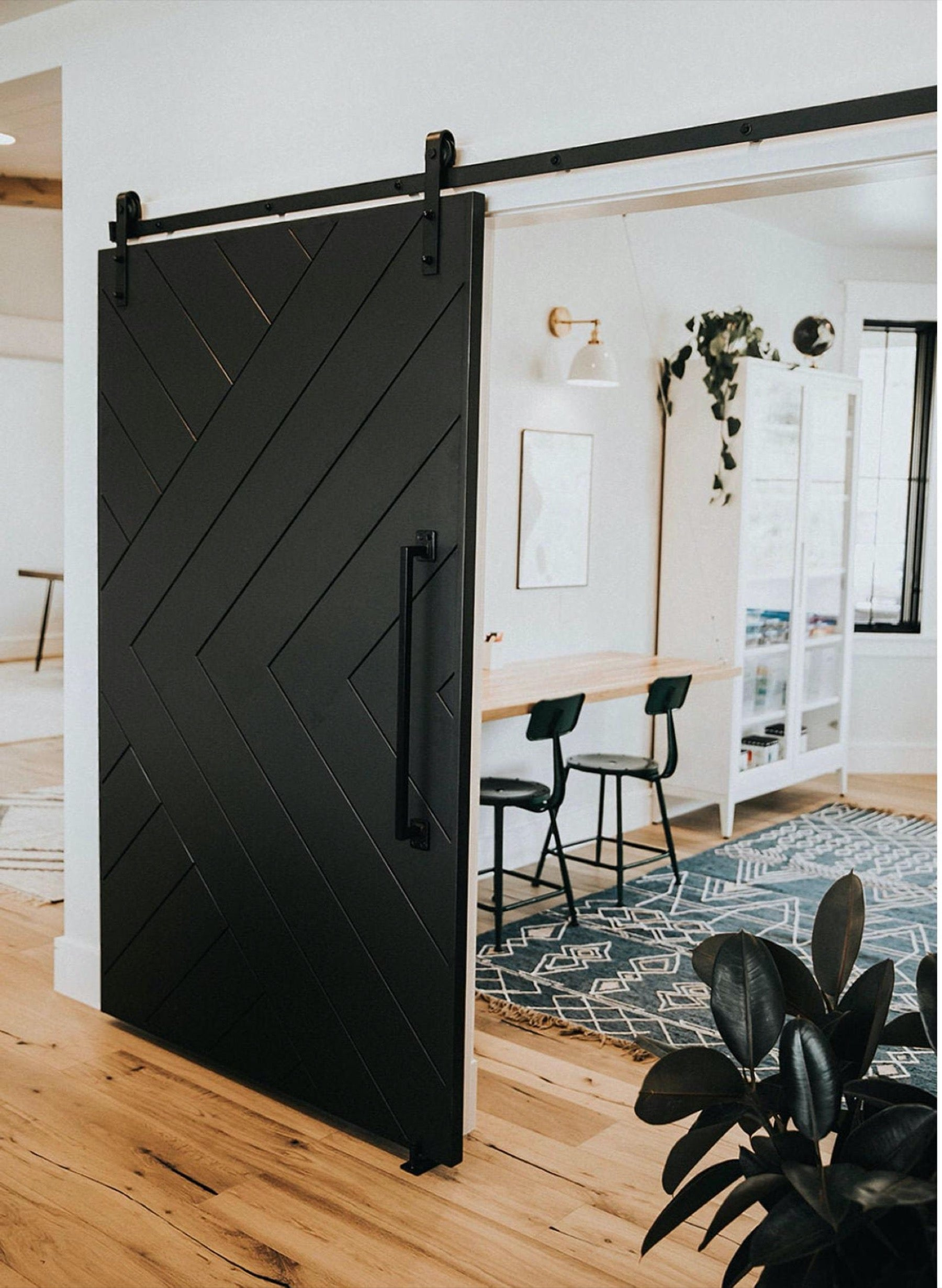 Black barn door in a modern farmhouse style