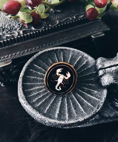Scorpion Ring - Gold Coin Ring, Enamel Ring, Animal Spirit Ring, Black and White Animal Ring - On ritual altar - occult ring lifestyle shot