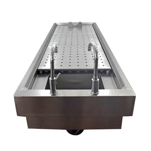 close up of stainless steel mortuary sink and drain plates