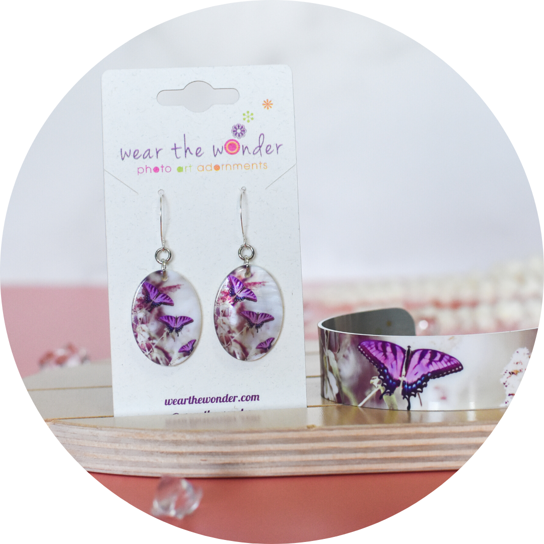 Close up on matching earrings and lavender butterfly bracelet | Wear the Wonder