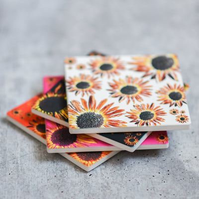 Stacked coaster view of all 4 sunflower coasters | Wear the Wonder