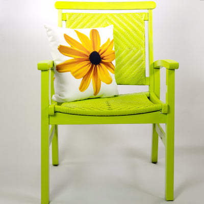 Black Eyed Susan Throw Pillow on Green Chair | Wear the Wonder