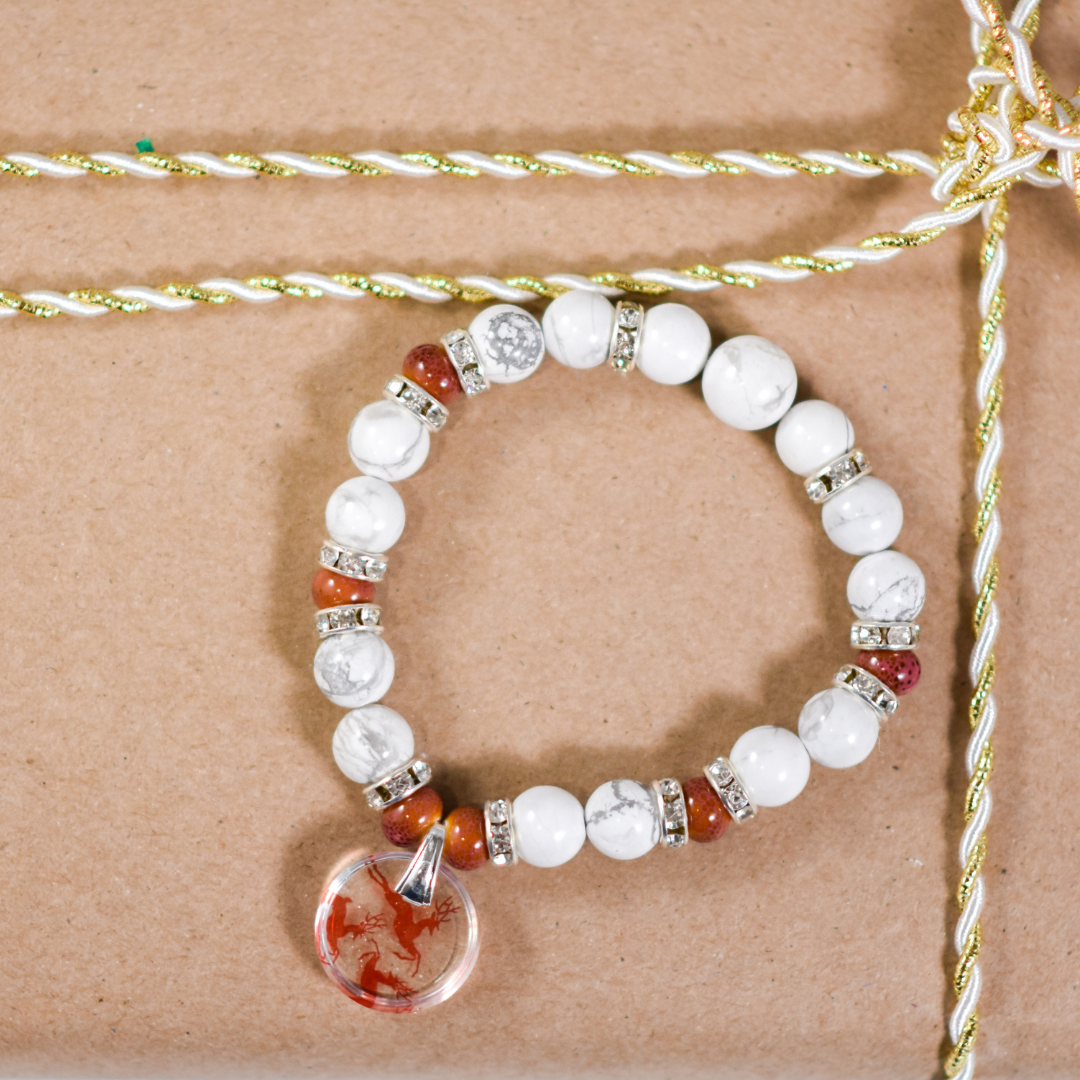 Reindeer Beaded Stretch Bracelet on a Present | Wear the Wonder