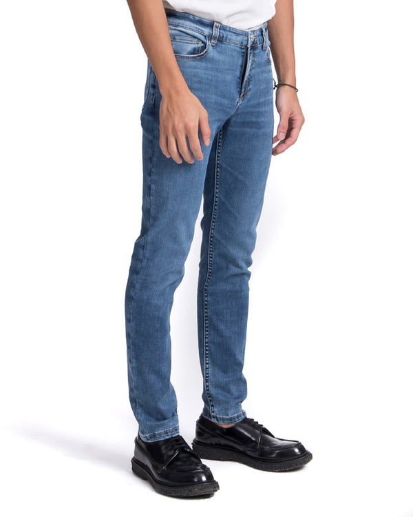 masculine slim fit mid blue jeans